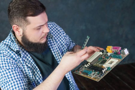 Service engineer working with pc hardware