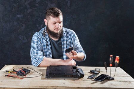 Photo for Male computer engineer fixing problem with laptop. Electronic device repair technology - Royalty Free Image