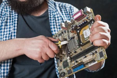 service engineer repairing pc motherboard