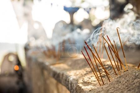 burning incenses in buddha temple