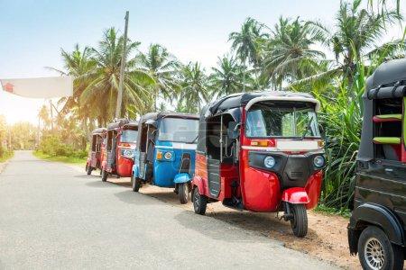Photo for Tuk-tuk cars on road of Sri Lanka. Ceylon traditional tourist transport, local taxi - Royalty Free Image