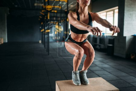 woman doing box jump exercise