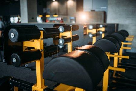 Photo for Empty gym interior. Strength training machines. Sport center equipment - Royalty Free Image