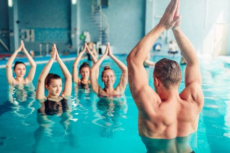 Photo for Aqua aerobics workout in water sport center, indoor swimming pool, recreational leisure - Royalty Free Image