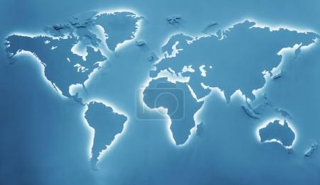 Photo pour Carte de la terre éclairée sur fond bleu. Continents avec rétro-éclairage blanc - image libre de droit