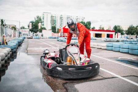 Photo for Karting racer wearing helmet on speed track. Go-kart motorsport - Royalty Free Image