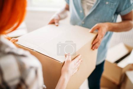 couple holding cardboard box