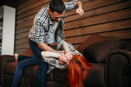 Photo pour Young man beating woman, domestic violence, family quarrel, aggressive husband. Problem and conflict relationship - image libre de droit