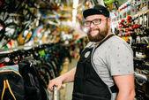 Bicycle mechanic in bike shop
