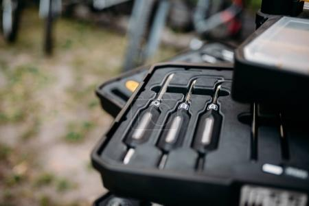 Photo for Bicycle tools in box, closeup, blur background. Bike equipment in toolbox. Professional workshop repair container - Royalty Free Image