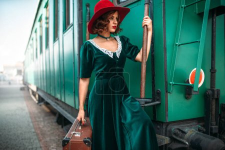 young woman against old railway wagon