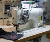 Professional sewing machine and black textile