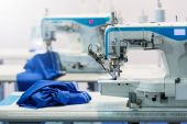 Professional sewing machine and blue textile