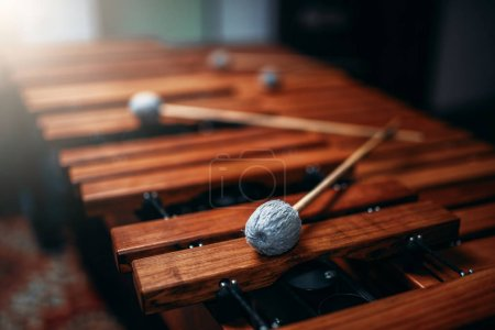 Xylophone with sticks closeup, wooden percussion i...