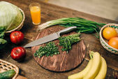 fresh fruits, herbs and vegetables on wooden table closeup. Healthy food concept. Organic nutrition, eco products