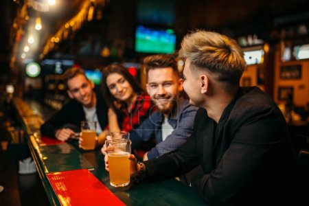 friends drinking beer at bar counter in sport pub, happy leisure of football fans