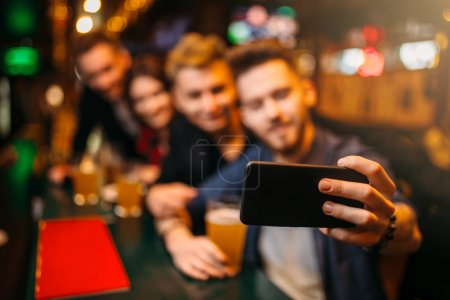 Photo for Friends taking selfie on phone camera in sport bar, happy leisure of football fans - Royalty Free Image