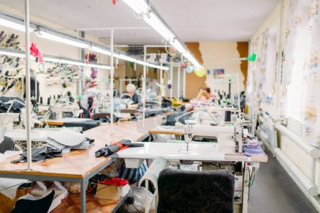 workshop for production of clothing, sewing machines at fabric. Dressmaking industry, Equipment for professional tailoring