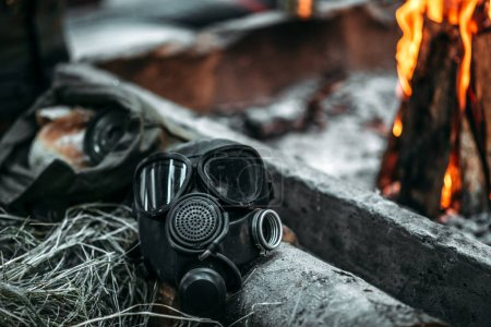 Gas mask against fire, post apocalyptic lifestyle, doomsday, horror of nuclear war, zone of pollution ecology concept