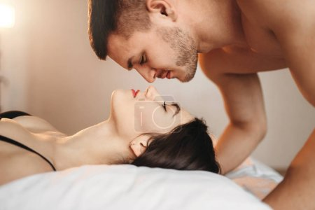 passionate love couple on bed, intimacy lovers, erotic games