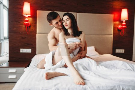 sexy love couple hugging on bed, relationship of lovers concept
