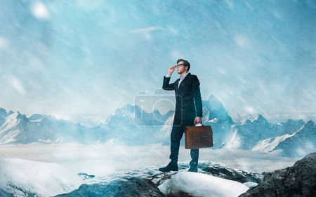 Photo for Difficult and risky business way concept, young businessman with leather briefcase in mountains - Royalty Free Image