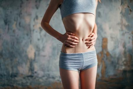 Photo for Woman with slim waist, weight loss concept - Royalty Free Image