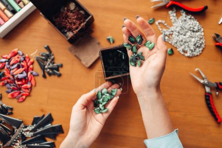 Photo for Female hands holding needlework accessories, master at workplace, handmade jewelry - Royalty Free Image