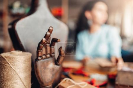 needlework tools and accessories, wooden hand and mannequin, closeup, female craftsman on background