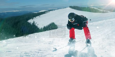 skier in helmet and glasses riding on snow hill, winter active sport, extreme lifestyle