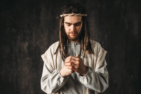 Jesus Christ praying, dark background, belief in god, christian faith
