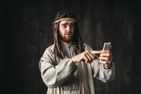 Jesus Christ holding mobile phone