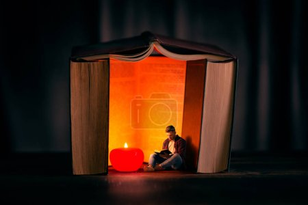 Small man in a big world of knowledge, student reads in a house built of books, scale effect. Reading concept