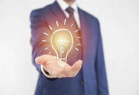 Photo for Businessman with idea light bulb - Royalty Free Image