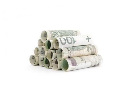 Photo pour Billets polonais enroulés isolés sur fond blanc - image libre de droit