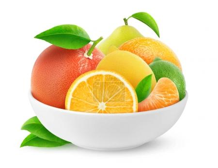 Photo for Isolated citrus fruits. Pile of citrus fruits (orange, lemon, lime, grapefruit, tangerine, pomelo) in ceramic bowl isolated on white background with clipping path - Royalty Free Image