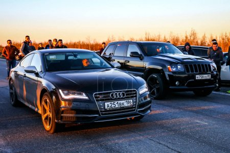 Audi S7 and Jeep Grand