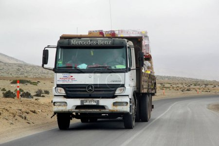 Atacama, Chile - November 18, 2015: Flat-bed truck Mercedes-Benz Atego at the interurban road.