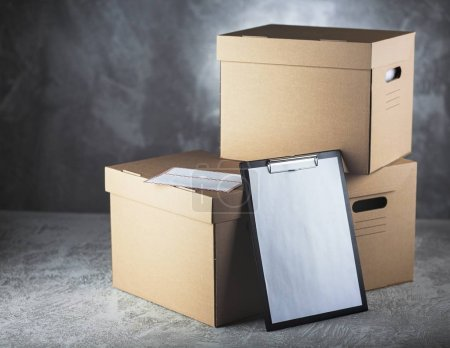 Photo for Cardboard box on grey concrete background - Royalty Free Image