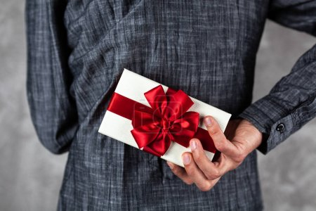Photo for Man holding a gift box in his hands - Royalty Free Image