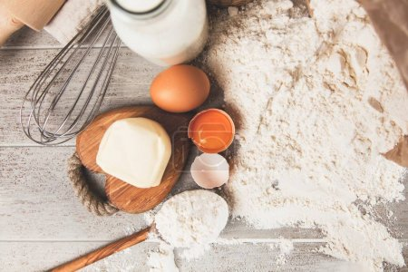 Photo for Eggs, flour and basic baking ingredients - Royalty Free Image