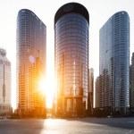 Modern office buildings in Hangzhou with sunbeam...