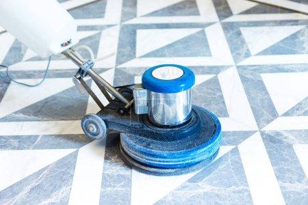 working polisher on marble floor