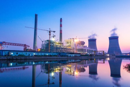 Photo for Modern waterfront power plant at sunset - Royalty Free Image