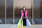 """Постер, картина, фотообои """"asian woman with shopping bags outdoors"""""""
