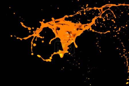 Photo pour Éclaboussure d'eau orange isolée sur fond noir - image libre de droit
