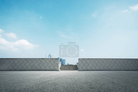 Photo for Empty road and cityscape of modern city in blue sky - Royalty Free Image