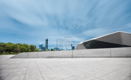 Photo for Cityscape and skyline of modern city from empty brick floor - Royalty Free Image