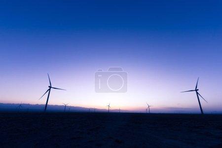 wind turbines in field at twilight