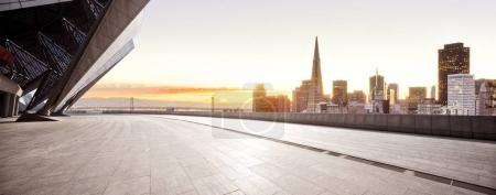 Photo for Empty brick floor with cityscape of San Francisco at sunrise - Royalty Free Image